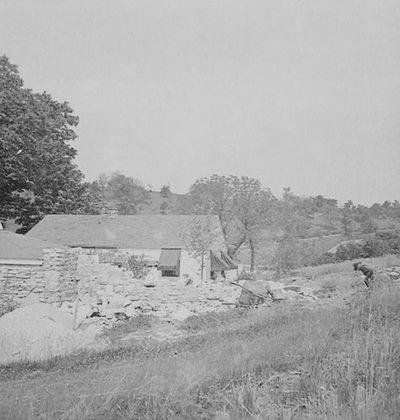 Robert Hicks building a stone wall at Boot Hill Farm