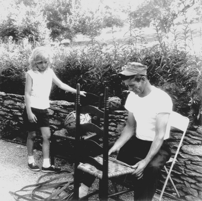 Traveling chair caners working in back yard at Boot Hill Farm