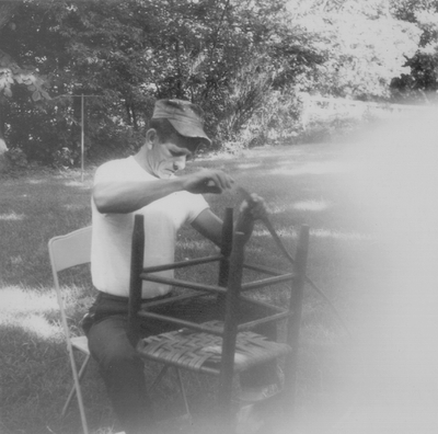 Traveling chair caners, working in the backyard at Boot Hill Farm