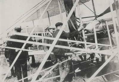 Orville Wright and the engine of his airship just after record-breaking flight; Paul Thompson