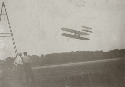 Wilber Wright and mechanic Taylor watching Orville Wright fly; Paul Thompson