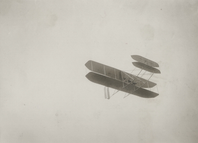 First Wright aeroplane model built after trial flights at Kitty Hawk, North Carolina; Orville Wright up; Paul Thompson