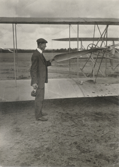 Wilbur Wright by his machine and Wilbur Wright and Zens (left) latest sensation of airship flights at LeMans, France; Paul Thompson