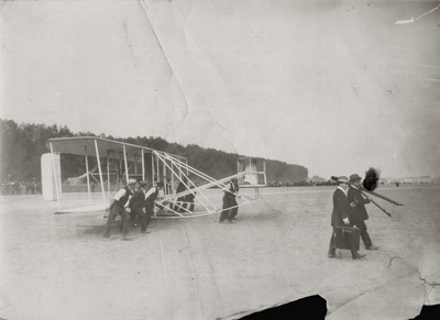 Bringing the Wright aeroplane onto the field in Berlin; Paul Thompson