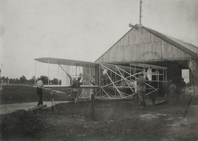 Wright Brothers' aeroplane leaving the barn to be put on the slide; Paul Thompson