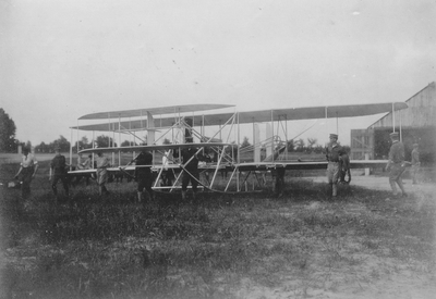 Wright Brother's aeroplane leaving the barn to be put on the slide; Paul Thompson