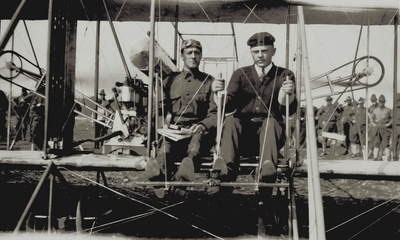 Lt. Foulois and Parmalee, who have been conducting war experiments with an Army aeroplane at San Antonio; Paul Thompson