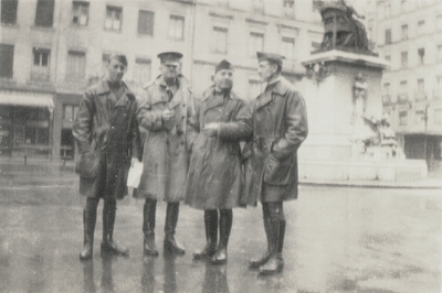 Four military persons posed in a square