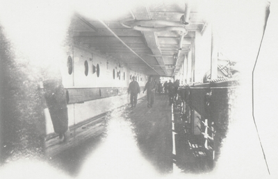 Photo on board ship: military personnel on walkway