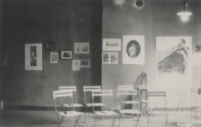 Photo of a studio with books placed on chairs