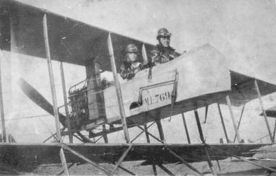2 men in biplane