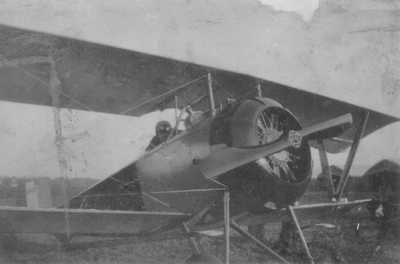 Pilot in biplane
