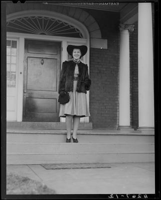 Jane Elgin Dudley standing in front of an entranceway to an                             unidentified building; (1940 Kentuckian) (University of                             Kentucky)