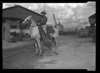 Man in uniform, on horse