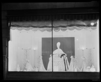 Seated mannequin in window (dark, barely discernible)