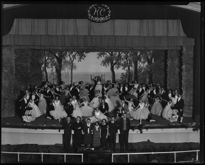 Henry Clay stage, filled w/ dancing girls in evening                             dresses
