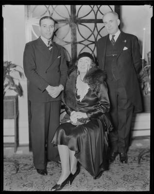 3 men, woman all dressed in party clothes
