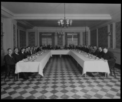 Men seated around a u-shaped table