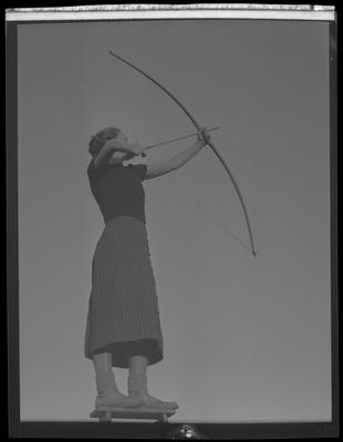 Young woman w/ bow and arrow