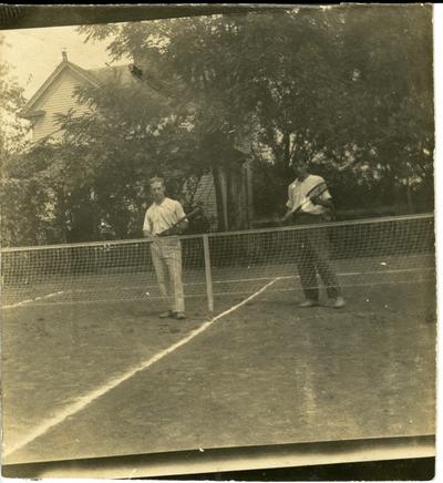 Two men on a tennis court circa 1914