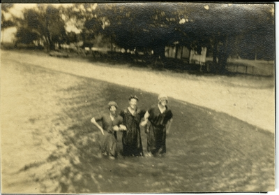 3 women standing in water circa 1914