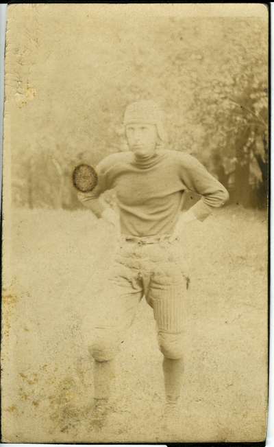 Man in a football uniform circa 1914