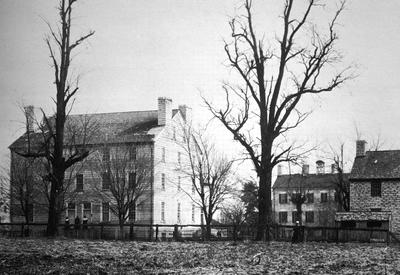 Center family house - Note on slide: Exterior view. The Simple Spirit. Thomas, Samuel W. [Harrodsburg, Ky.] Pleasant Hill Press, 1973. p. 22