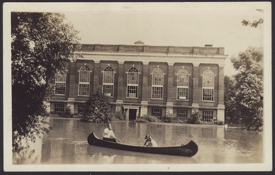 Men's Gymnasium, Alumni Gym; Three people in canoe during flood