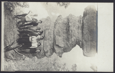 Hiking Scene, Nine Men in Front of a Rock