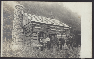 Group of Men in Front of a Cabin
