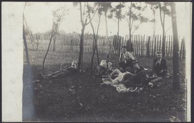 Men Lying In Field