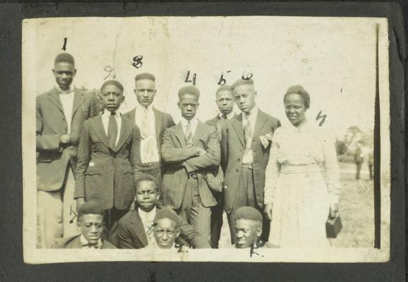 Page 3 [R]: Ten unidentified black men and one woman in a group
