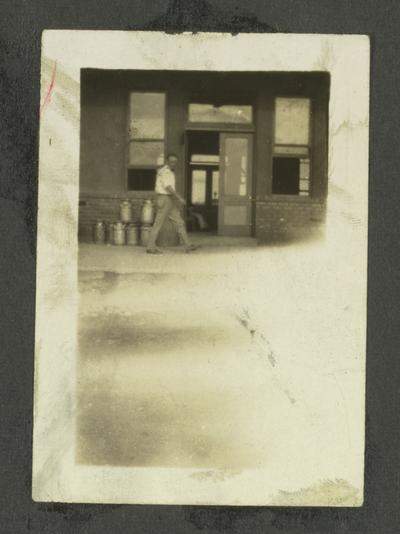 Page 13: Unidentified black man walking in front of entrance to a building