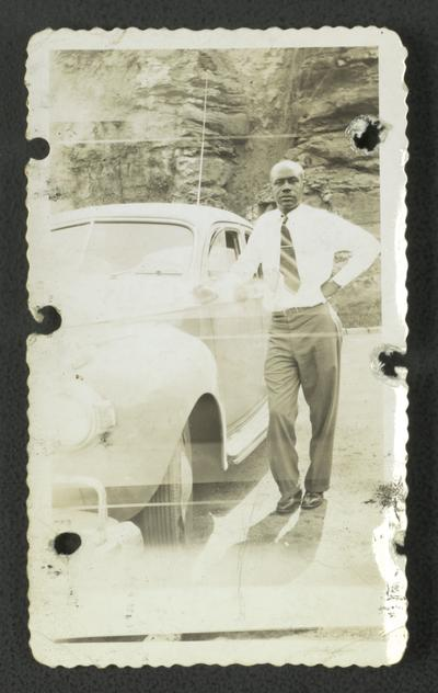 On top of Norris Dam, Florizel Wilson posing with car