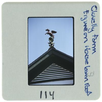 Clovelly Farm figure on horse barn roof