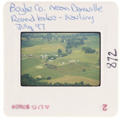 Boyle County near Danville, round bales - hauling