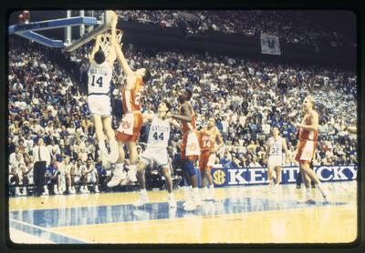 Jeff Brassow dunking, Rick Pitino in background, Gimel Martinez and Richie Farmer watching, UK vs. Auburn