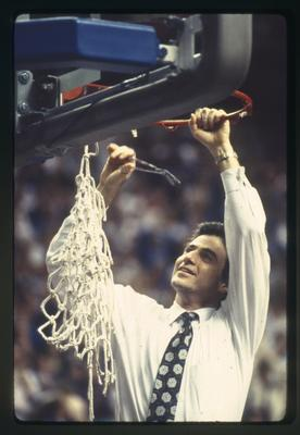 Rick Pitino cutting down net after UK vs. Auburn game
