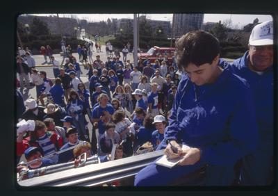 Rick Pitino signs autographs in UK parade