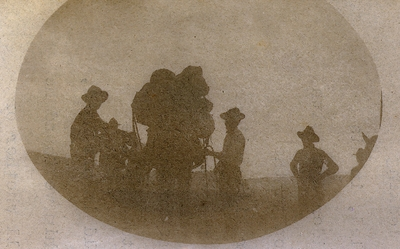Untitled; a scene of packers; one is pulling on cinch to secure load to a mule's body; letter discusses the image and packing a mule for a trip; letter from Thomas L. Smith to Lyne Starling Pepper Smith