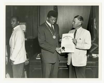 Kentucky Governor Bert T. Combs presenting an award to Muhammad Ali