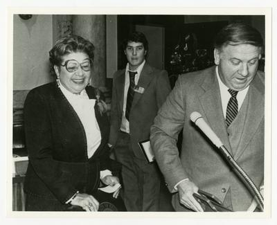Georgia Davis Powers and two other men standing