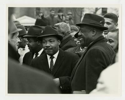 Dr. Martin Luther King, Jr., standing in a crowd