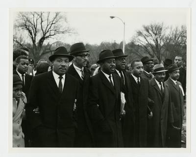 Dr. Martin Luther King, Jr., with group of men leading the march. Ralph David Abernathy is second man from King's right and Frank Stanley Jr. is fourth man from right