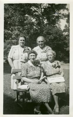 Margaret Wickliffe Preston Johnson (1885-1964) at a Daughters of the American Revolution (DAR) meeting, handwritten in ink on back of image