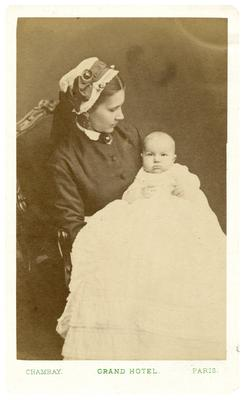 Infant with unidentified woman, handwritten on back in ink