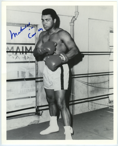 Muhammad Ali in the boxing ring, autographed