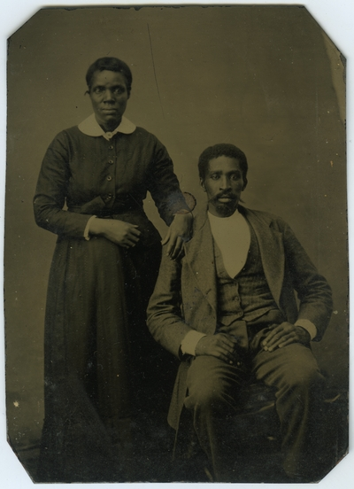 Unidentified African American male and female ; photo located on page 16 of album