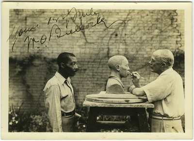 Dr. Waller Overton Bullock sculpting the bust of an unidentified African American man