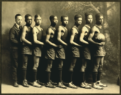 African American men's basketball team and coach E.J. Hooper at Oliver High School in Winchester, Kentucky